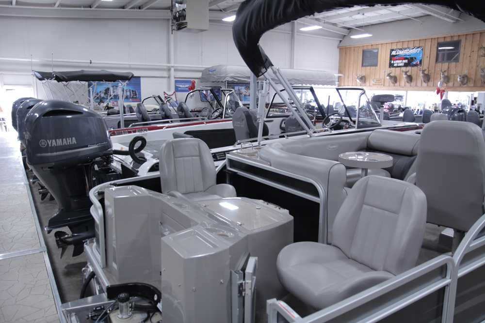 premier pontoon boat in showroom
